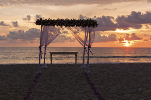 Sunset behind the decoratoin for the wedding ceremony that finished in few hours before