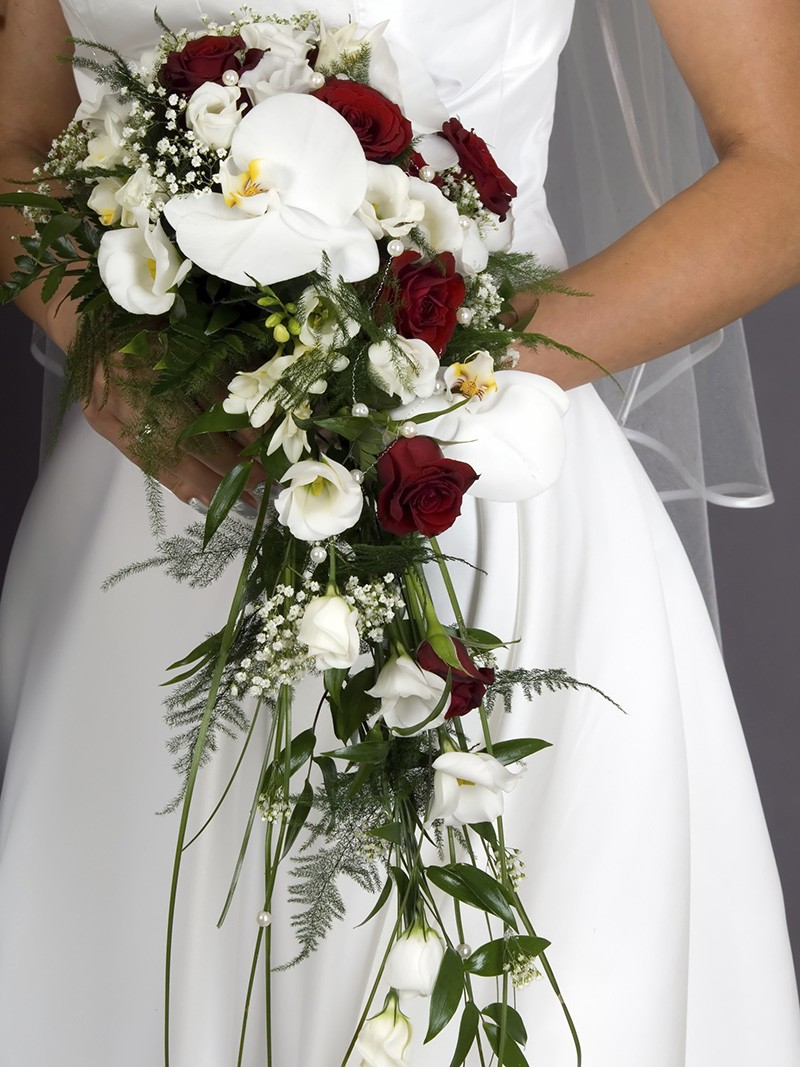 Bride holding in her hands the colorful weeding bouquet